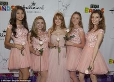 I love the dresses her court were wearing they look so girls and fun!