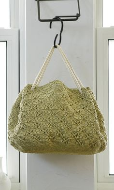 Crocheted handbag. Free pdf pattern & diagram here: http://gosyo.co.jp/english/pattern/eHTML/ePDF/1205/4w/212ss-26_Amian_Purse.pdf.