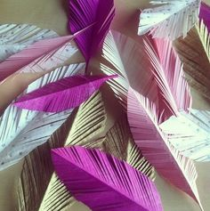 Paper Feather Craft Ideas - http://www.diyinspired.com/paper-feather-craft-ideas/ #diyinspireddotcom