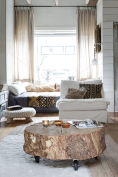 Tree stump coffee table on casters.
