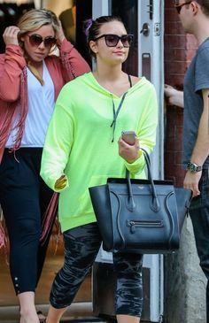 Demi Lovato Wears Electric Lime Green Shirt & Black & Grey Leggings  + Black Celine Bag - http://oceanup.com/2014/06/29/demi-lovato-wears-electric-lime-green-shirt-black-grey-leggings-black-celine-bag/