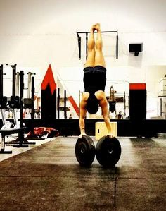 hand stand on barbell plates