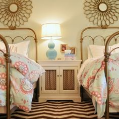 This room for two girls plays on colors of coral and turquoise. Design by Fieldstone Hill Design.