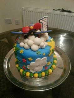 How time flies themed 1st birthday cake