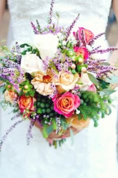 Holding my wedding flowers. They were even more beautiful in person. Yosemite wedding flowers by Coarsegold Flower Shop