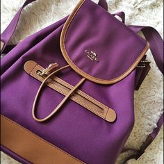 "NWT Coach Sawyer in Canvas Plum Backpack Authentic NWT Coach Sawyer Backpack in Canvas style in Plum Purple -Canvas -Flap Closure -Top Handle -Outside Zip -11 1/4""(L) x 12 3/4""(H) x 4 1/4""(W) Coach Bags Backpacks"