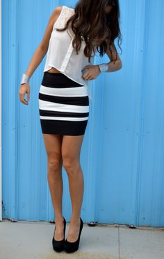 Sheer white button up top with black and white stripe skirt and silver cuff bracelets