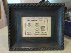 """The Henson Family"" Designed and stitched by Yesterday Once More Primitives."