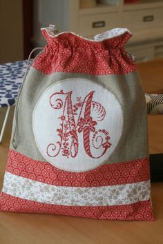 would be so pretty for a 'shoe bag' when going to the masjid Embroidery Works, Embroidery Monogram, Machine Embroidery, Cross Stitching, Cross Stitch Embroidery, Cross Stitch Finishing, Cross Stitch Alphabet, Fabric Bags, Quilted Bag