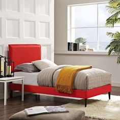 Camille Twin Fabric Platform Bed with Round Tapered Legs, Atomic Red - Accelerate your bedroom decor with the Camille Platform Bed. Made with a solid wood frame upholstered in polyester fabric, Camille features tapered wood legs, plastic foot glides, stylish headboard, and ten sturdy wood slats with a centered supporting bar and two support legs for enhanced stability. Due to the wooden slat support system, the use of a box spring is unnecessary. Camille supports memory foam mattresses such…
