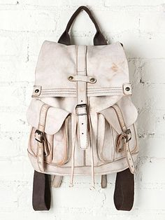 Jericho Backpack - Distressed leather backpack with two front pockets and a flap closure with buckle strap detailing. Canvas shoulder straps with adjustable buckle and Canvas handle at the top. *By Bed   Stu + Free People… In love with this bag.