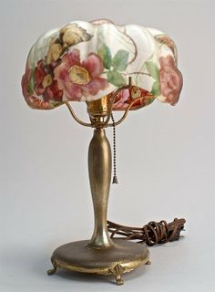 """20TH CENTURY PAIRPOINT TABLE LAMP with flower and butterfly-decorated puffy shade. Base and shade signed """"Pairpoint"""". Height 14 1/2"""". Repaired crack in shade."""