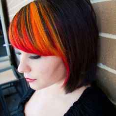 Orange and red hair color. Love the placement.