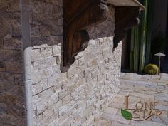 Split face travertine on barbecue with wooden corbels in Scottsdale, AZ. - www.lonestaraz.com