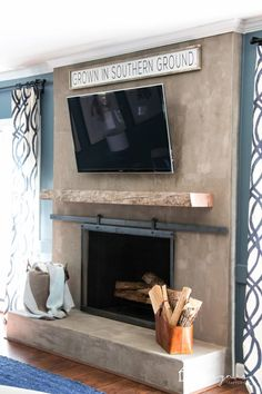 Fantastic Snap Shots concrete Fireplace Hearth Ideas Looking for ideas to give your outdated fireplace a makeover? This budget friendly DIY fireplace up Tv Over Fireplace, Fireplace Update, Fireplace Cover, Concrete Fireplace, Fireplace Hearth, Fireplace Remodel, Fireplace Surrounds, Fireplace Design, Diy Concrete