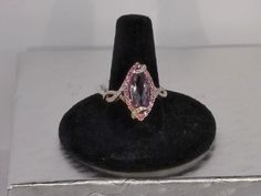 Matching ring. Large amethyst surrounded by pink sapphires accented by diamonds in a rose and white gold mounting.
