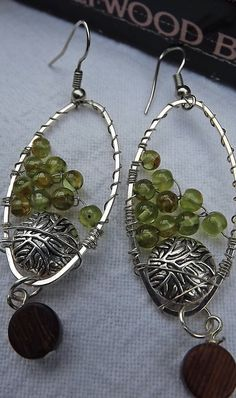 Wire wrapped peridot pewter and wood bead. by pebblesnglass, $12.00