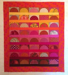 40 African Sunsets made in shweshwe by Céleste Compion. I used the pattern 40 Prairie Sunsets from http://daydreamsofquilts.blogspot.ca/