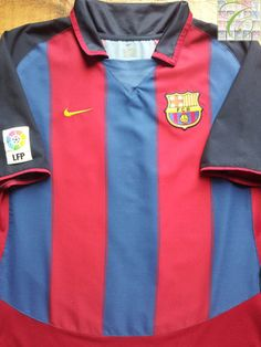 Relive Barcelona's 2003/2004 La Liga season with this vintage Nike home football shirt.