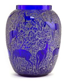 R. LALIQUE BLUE GLASS BICHES VASE WITH WHITE PATINA Circa 1932