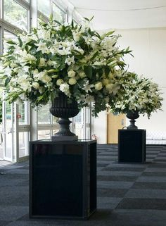 .classic elegance white flowers wedding ceremony urn arrangements