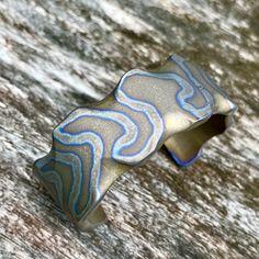 Titanium cuff bracelet with stonewashed random anodizing ... Www.Tisurvival.Com #tisurvival #titanium #pocketdump #anodizedtitanium #dailybadass #edc #edcpocketdump #edcig #bracelet #jewelry Fashion Bracelets, Cuff Bracelets, Titanium Jewelry, Biker Style, Edc, Dog Tags, Wedding Bands, Random, Handmade