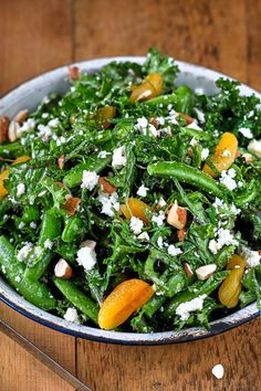 NYT Cooking: Here's a recipe Mark Bittman picked up on a road trip with his daughter across the United States, from the Black Market restaurant in Indianapolis. Kale and sugar snap peas combine with a dressing of ginger, miso and rice vinegar, with dried apricots and feta cheese, almonds and mint — a riot of flavors, and an excellent meal.