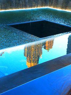 Buildings reflected in the Memorial Pool at the National September 11 Memorial. #nyc #wtc #911memorial