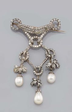 A NATURAL PEARL AND DIAMOND DEVANT DE CORSAGE MID 19TH CENTURY. designed as a cushion-shaped diamond set drape cascading between similar set rings, with three foliate shaped pendants terminating with a drop-shape natural pearl pendent drop capped by rose diamonds, a drop to the centre deficient, accompanied by a Report from the Netherlands Gemmological Laboratory no. P4624, stating all three drop-shaped pearls to be of natural origin, one diamond deficient (2)