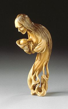 Chikuyosai Tomochika (Japan, Edo period, Tokyo) Ghost Caring for Her Child, mid-19th century Netsuke, Ivory with staining