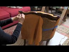 Bobanne Kalkofen, Professor Interior Design at Johnson County Community College demonstrates the process she used to reupholster an old chair. This chair is a found object, that was ready for the trash truck.