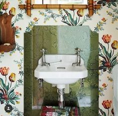 Discover the best design ideas for bathrooms, including this small bathroom with floral wallpaper. A small bathroom has been papered with 'Botanical Tulips' a wallpaper by Twigs, available from Simon Playle. This is paired with bamboo furniture. Small Bathroom Wallpaper, Wallpaper Uk, Wallpaper Ideas, Estilo Tropical, Victorian Cottage, Bamboo Furniture, Cheap Furniture, Beautiful Bathrooms, Modern Bathrooms