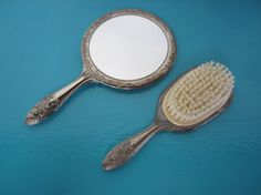 A classic beautiful vanity set including the brush and mirror. The set is silver plated and decorated with designs and flowers.