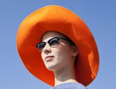 Vika Gazinskaya s orange hat radiates as brightly as the sun. Photo by  Phill Taylor. 9d602a36176b