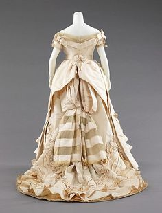 Ball gown Attributed to House of Worth  Designer: Attributed to Charles Frederick Worth  Date: ca. 1872 Culture: probably French Medium: silk Accession Number: 2009.300.339a–c