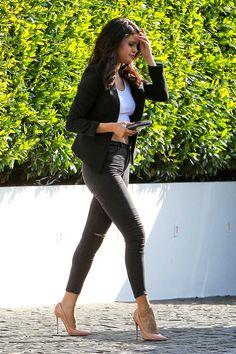 Selena Gomez street style with skinny jeans, white tee, black blazer and Christian Louboutin heels.