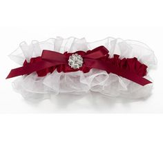 This beautiful white sheer and red satin wedding garter is adorned with a bold contrasting red satin bow in the middle decorated with a silver-plated rhinestone ornament.  A great keepsake for the bride.