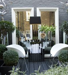 Amazing art deco, outdoors mirrored console table surrounded by two large white wooden wall mirrors. Venetian inspired and perfect for summer barbecues and cocktail parties. By Simpsons Mirrors & Furniture