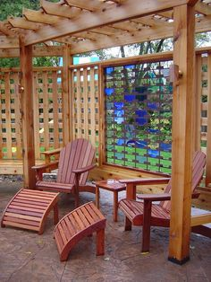 I want to curl up with a glass of wine under this arbor/trellis combination!