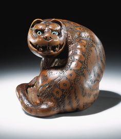 Japanese wooden netsuke, c.1750–1850, in the form of a tiger, symbol of courage. (Victoria & Albert Museum)