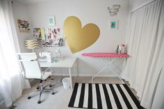 i liked the board with the scissors and the threads on the walls, good use of the space. (also the ironing board is cute)