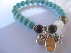 DIY Boho-Chic LOVE bracelet kit. Turquoise magnesite, silver tone charms, heart, jasmine flower, glass beads. Limited Edition. Gift packaged