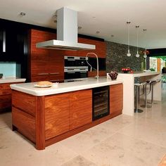 Kitchen island and breakfast bar idea. Not sure about the colours (or the price!) but like the idea of 2 long islands separating kitchen from dining space.