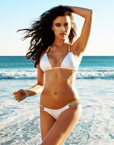With her thin body and Dark brown hairtype without bra (cup size 34B) on the beach in bikini