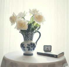 White roses by the window.