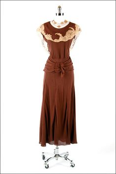 1930s dress - like the wide hip belt and lace.