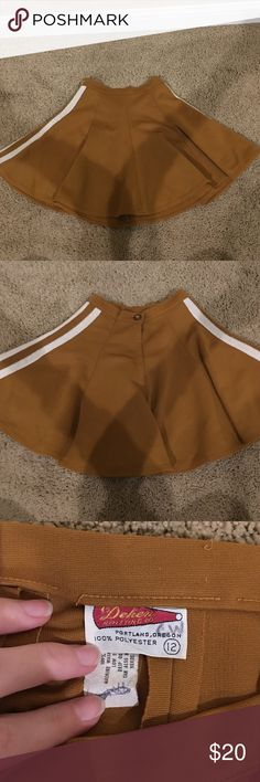 LAST CHANCE!!!! Retro Cheer Skirt 💕 There seems to be nothing wrong with this item, I have never worn it myself (it was sadly too small)! The color of it is white and mustard! The tag says size 12, but it definitely doesn't fit like one. Fits more like a size S or MAYBE M would. Willing to negotiate :-) Dehen Knitting Co. Skirts