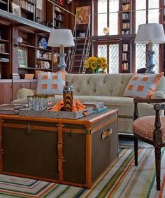 Use an old steamer trunk as a living room table. Sometimes you must improvise in order to obtain the desired result. If you don't have a proper table for this kind of interior design, use a steamer trunk or any other suitcase to fill the empty space.