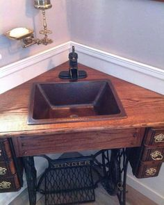 Corner sink made from antique sewing machine cabinet! I wouldn't want to do this to a trettle sewing machine that is all complete, but this would be a darling idea for one missing it's machine! Repurposed Furniture, Diy Furniture, Antique Furniture, Rustic Furniture, Outdoor Furniture, Handmade Furniture, Furniture Vanity, Furniture Chairs, Kitchen Furniture