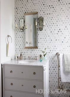Pinwheel tiles are a subtle but fun touch in this kids' bathroom. | Photographer: Stacey Brandford | Designer: Sarah Richardson